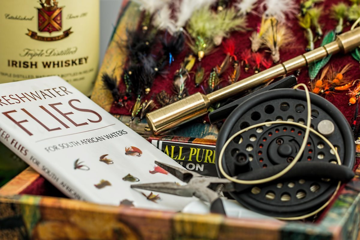 fly fishing book, rod and reel
