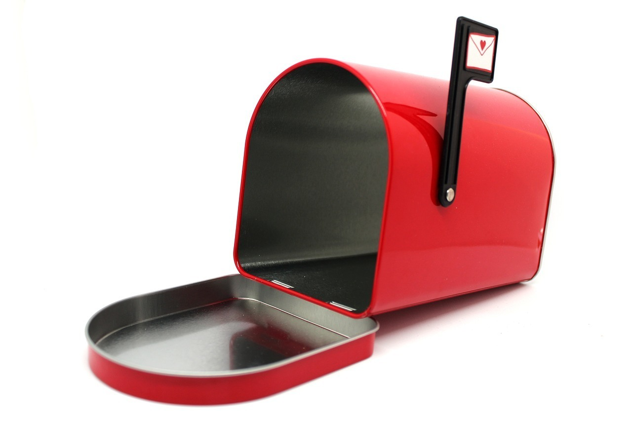 red mailbox open to receive