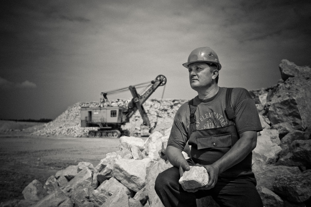 miner with machine in background