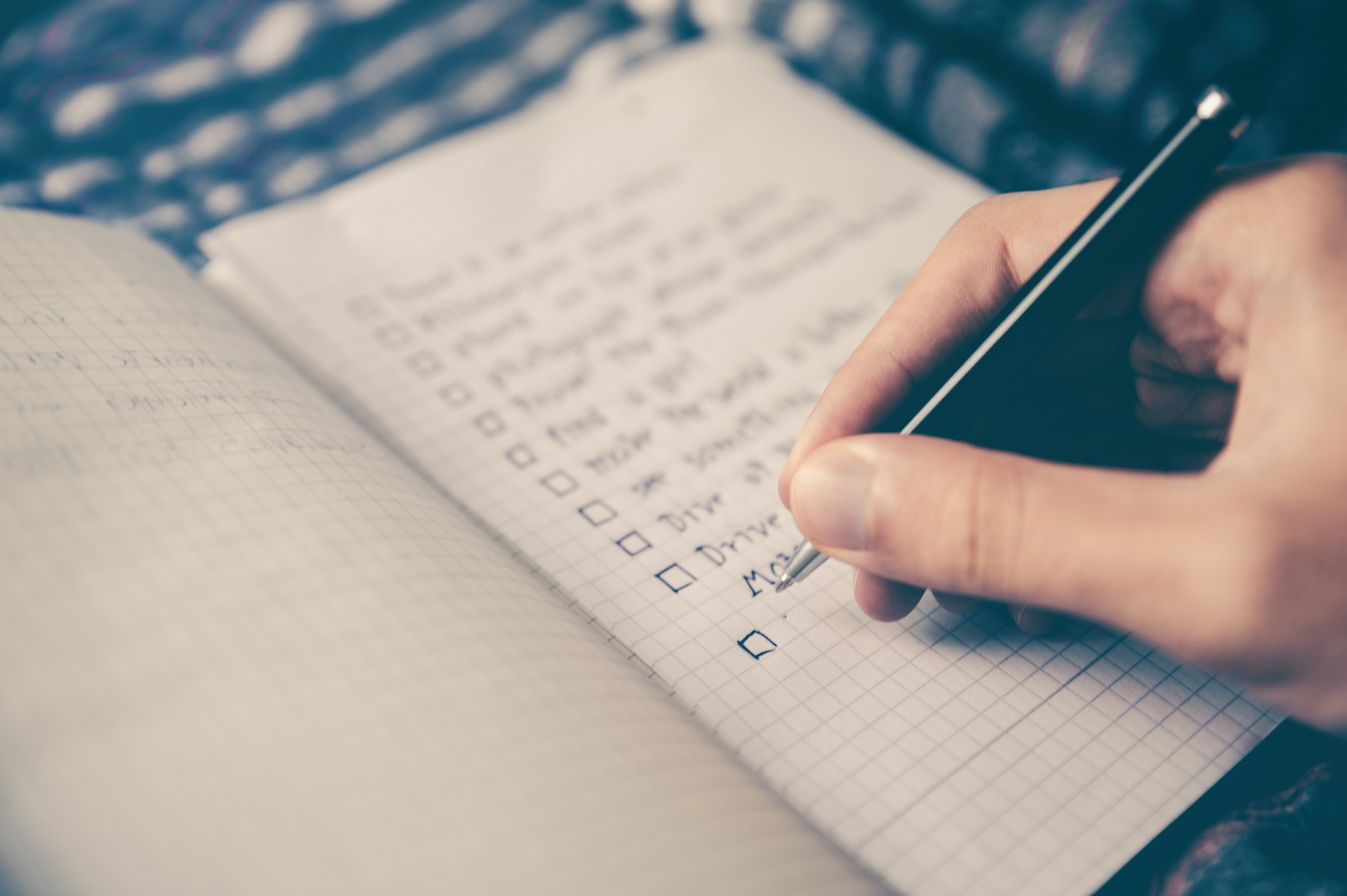 person writing in to do list