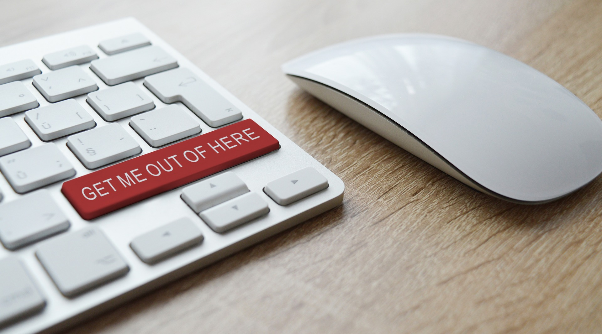 Keyboard with Get me out of here key in red