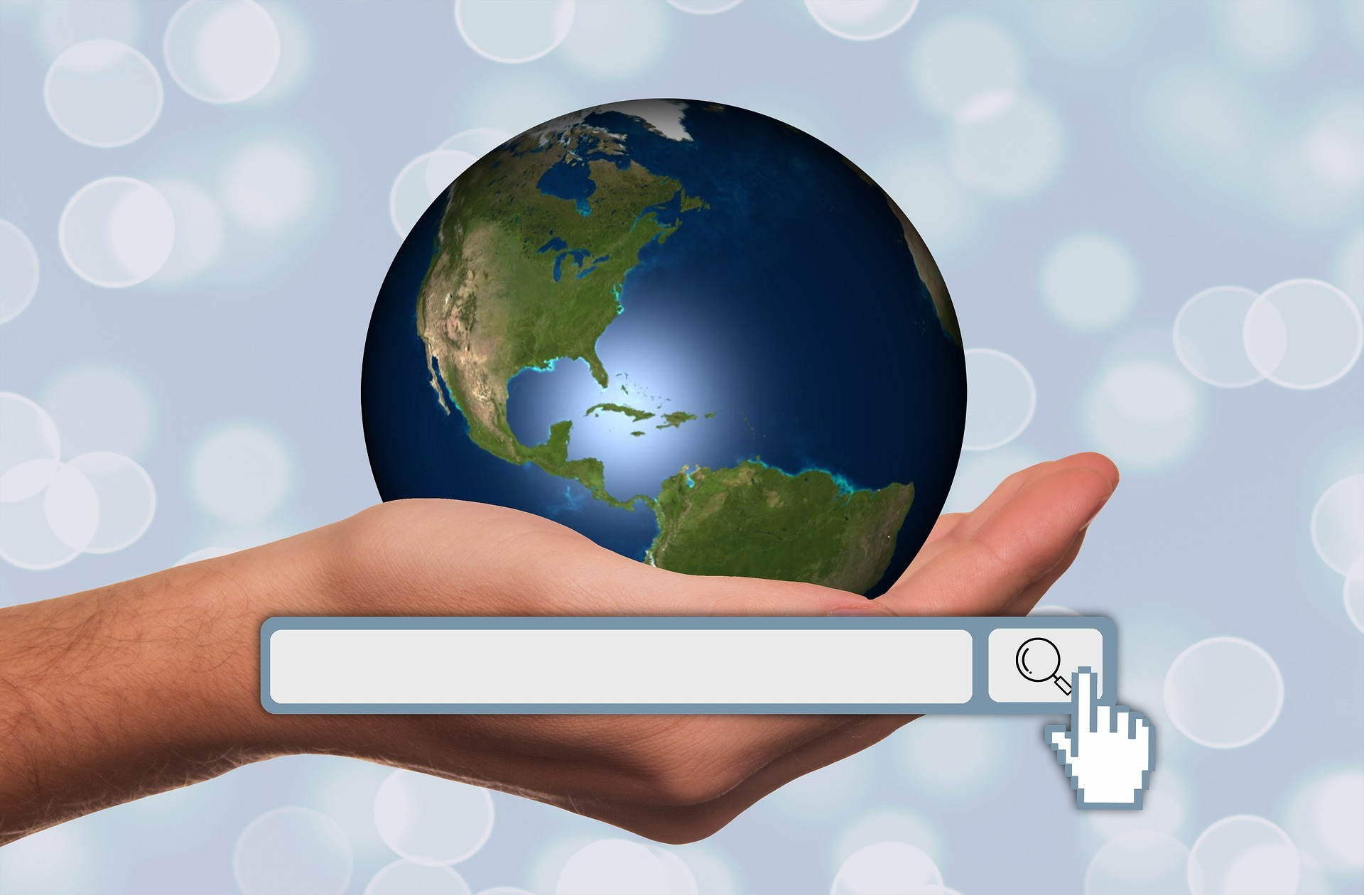 search box with hand holding the world
